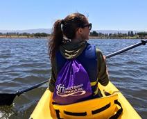 woman kayaking at retreat
